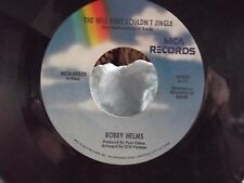 BOBBY HELMS JINGLE BELL ROCK / THE BELL THAT COULDNT JINGLE ON MCA RECORDS