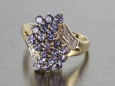 Naural Tanzanite and Diamond Cluster Ring in 14K Yellow Gold