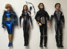 The Hunger Games Barbie Lot Of 4: Effie, Katniss, And 2 Ken Dolls