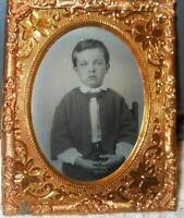 1/9th size Tintype of a young boy in a Brass frame