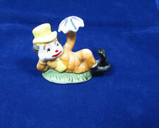 Vintage Clown in Yellow Hat Brown Suit  On Grass Patch Figurine