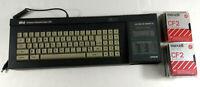 Amstrad CPC 6128 Ordinateur Vintage AZERTY Semi HS avec 15 Disquettes