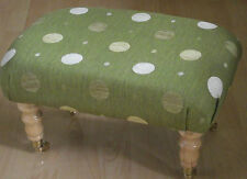 Superb new green spotted chenille footstool with light wood luxury castor legs