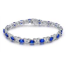 Oval-cut 6x4mm Created Blue Sapphire Adjustable Tennis Bracelet in 925 Silver