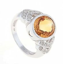 18Kt. White Gold Oval Citrine and Diamond Ladies November Birthstone Ring