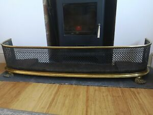 Fire fender kerb black steel and brass with lions paw claw feet