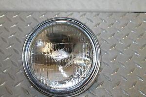 1978 SUZUKI SP370 HEADLIGHT BULB TRIM RING 35127-29610