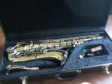 Used silver maestro tenor saxophone with mouthpiece and box of 9 reeds