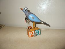 Decorative painted wooden carving of bird with found objects, blocks no. 29, 79