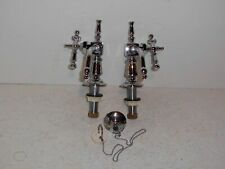 Pair of NOS reproduction Victorian faucets, with sink plug.