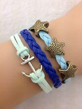 Bracelet bleu turquoise étoiles des mers et ancre de bateau. Top tendance