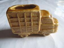 Porte cure dent en forme de camion en faïence ocre