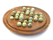Antique turned wooden solitaire board with green hardstone balls marbles