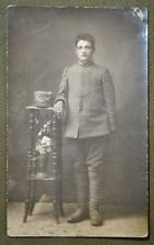 Wwi Italian Soldier Rppc - Standing At A Table w/ Hat Off & Cigarette In Hand