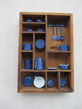 Display of miniature dishes, cookware, tableware, etc.
