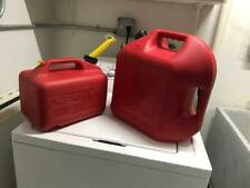 Two Red Plastic Gas Cans 1 is 5 Gallons and the other is 2.5 Gallons