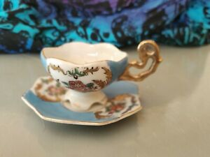 Fine bone china miniature tea cup and saucer