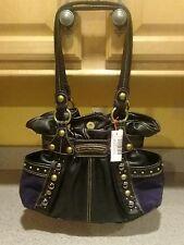 Kathy Van Zeeland black handbag with gold lining