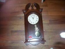 Used Dual Chimes Pendulum Quartz  number 625- 253 Howard Miller Wall Clock