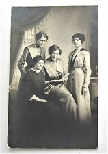 RPPC Ladies Looking at an ALBUM Photographs Postcards Real Photo Postcard AZO