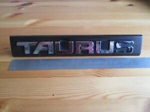 Original Ford Taurus car badge / lettering. mounted. desk sign, paperweight