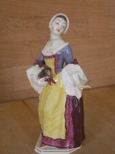 LATE 19TH EARLY 20TH CENTURY NYMPHENBURG FIGURE OF A LADY HOLDING A DOG