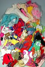 A large selection of vintage Barbie doll clothing & accessories