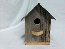 Vintage birdhouse made out of old barn wood and old metal new with rustic look