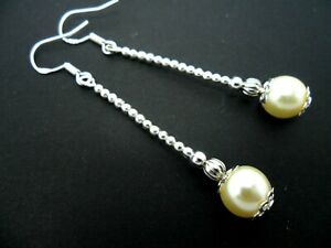 A PAIR OF LONG IVORY GLASS PEARL EARRINGS WITH 925 SOLID SILVER HOOKS. NEW..