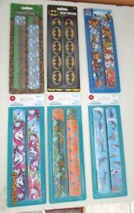 SLAP RULER BRACELETS...4 PACK.. ASSORTED DESIGNS..FOR BOYS OR GIRLS