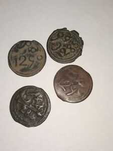 Four coins from the ancient Moroccan currency The Jewish six-pointed star