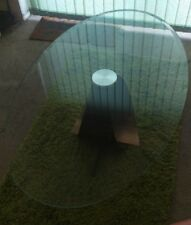 glass oval coffee table with steel scroll stand. Reduced.