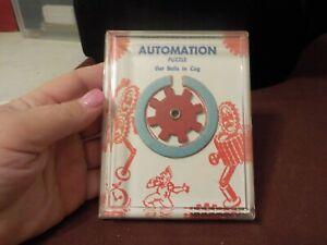 VINTAGE AUTOMATION PUZZLE GET BALLS IN COG-