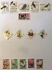 Bhutan mint stamps X 15 Flowers, Birds, Butterflies