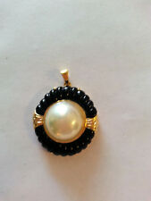 Brand new Mabe Pearl pendant with black Onyx & diamonds.