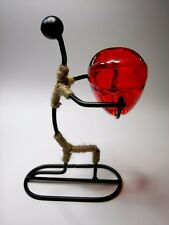 Metal Art Contemporary Figurine Carrying Red Glass Candle Holder