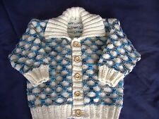 babys hand knitted cardigan in vanilla and jazzy