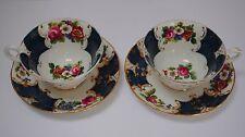 Paire de tasses XIXème en porcelaine fine de Paris décor floral goût de Sèvres