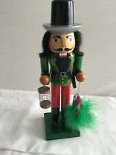14 INCH  NUTCRACKER  HOLDING A PARROT AND CAGE