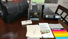 Vintage Polaroid SX-70 se sonar onestep land camera with flash and case..