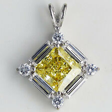 P12140 14K Gold CZ 5 carat total canary center baguette and round side pendant