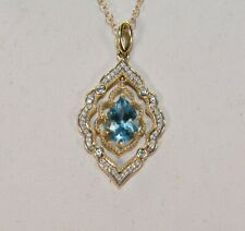 Zales Disney 10 K Yellow Gold Enchanted Aladin Blue Topaz & Diamond Pendant