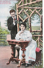 Romance Postcard - Young Man Stood and Young Lady Sat at Table Writing  XX675