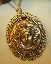 Lovely Swirled Starburst Rimmed Raised Face of Goddess Goldtone Pendant Necklace