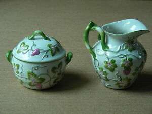 PORCELAIN (FLORAL RELIEF) CREAMER AND SUGAR BOWL WITH LID ITALY