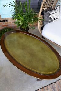 Mid century Hollywood regency leather top oval coffee table