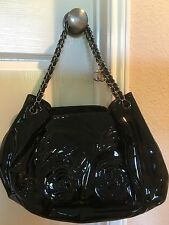 Chanel Camellia Drawstring Patent Leather Bag