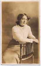 Vintage Sepia Postcard of a seated Woman - Canada