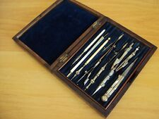 An Antique Wooden Rose Wood Box Of 13 Drawing Instruments