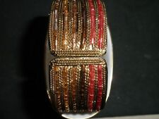 LARGE BEADED STRETCH BACELET IN REDS,BROWNS AND PALE ORANGE